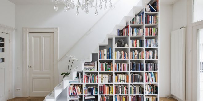 a diy bookcase in a staircase is one of many creative book storage QLFEQJY