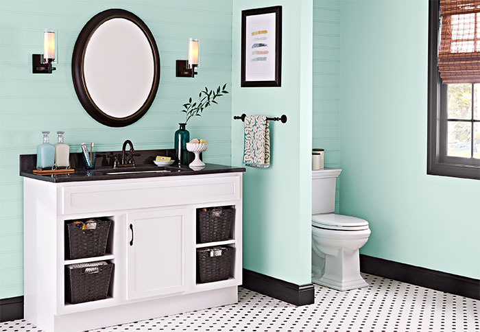 bathroom colors green walls and white-painted vanity EQUGZPP