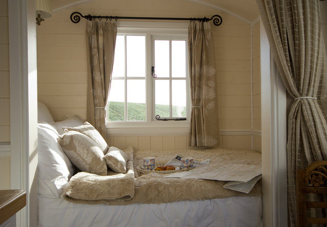 bedroom curtains small farmhouse bedroom idea in other with beige walls TXCVRIY