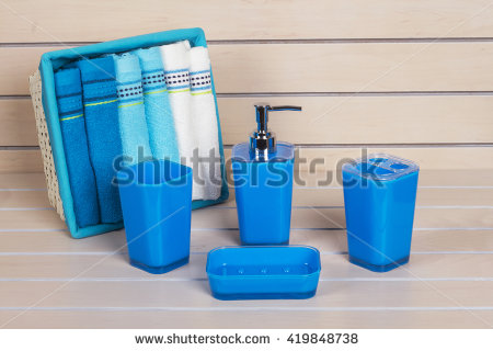 blue bathroom accessories with blue and white on wooden shelf VWKYXGG