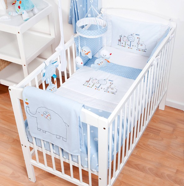 cot bedding sets hello ernest cosi cot 4 piece bedding set in blue on a cot MHDDVCB