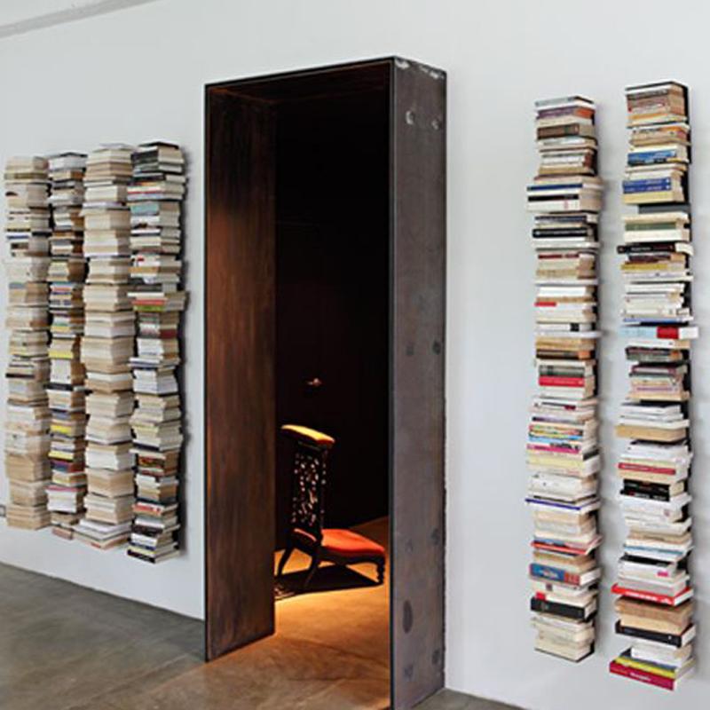 floating bookshelves next to door IXARMRA