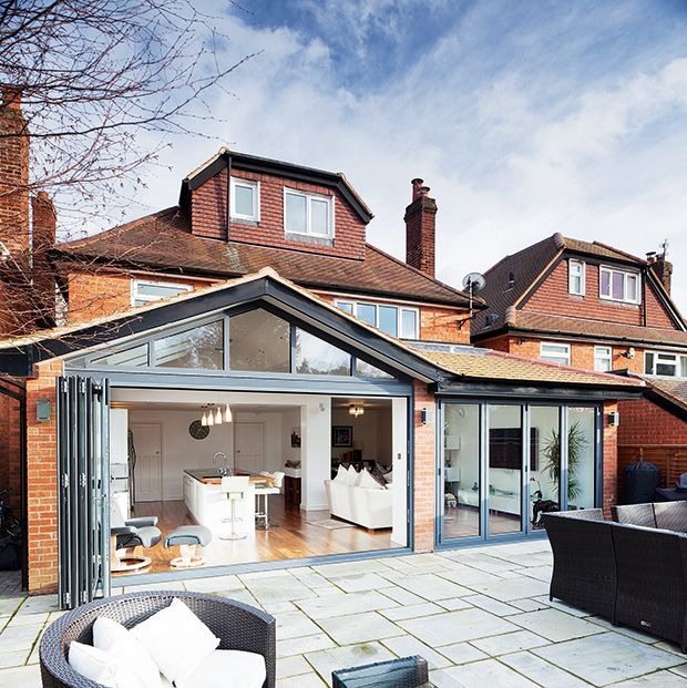 kitchen extensions powder coated aluminium bi-fold doors on a glazed kitchen extension YBSWFZV