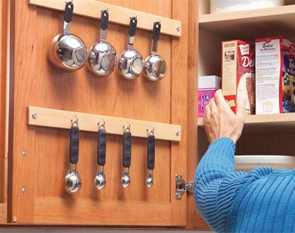 kitchen storage solutions 33. use the inside of your cabinet doors to store smaller utensils. 34 YKUOSIQ