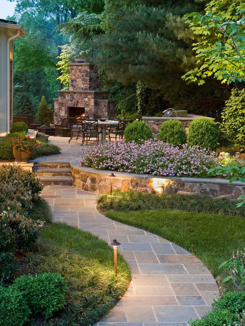 landscape ideas photo of a large traditional backyard stone landscaping in dc metro with a ALPEEDA