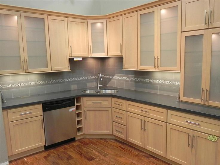 light maple kitchen cabinets with solid grey countertop and grey backsplash GNMKTBY
