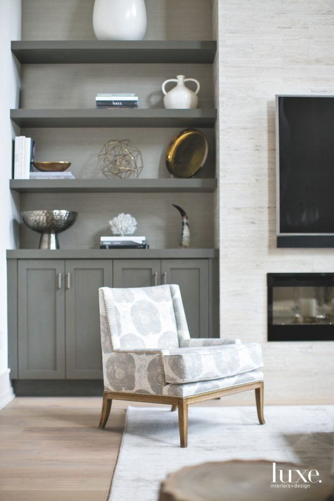 living room cabinets gray cabinets, television, and a comfy chair make the perfect living room XEPBBRJ