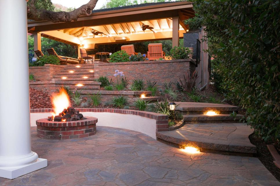 outdoor kitchen raised patio with landscape lighting IQXJZUZ