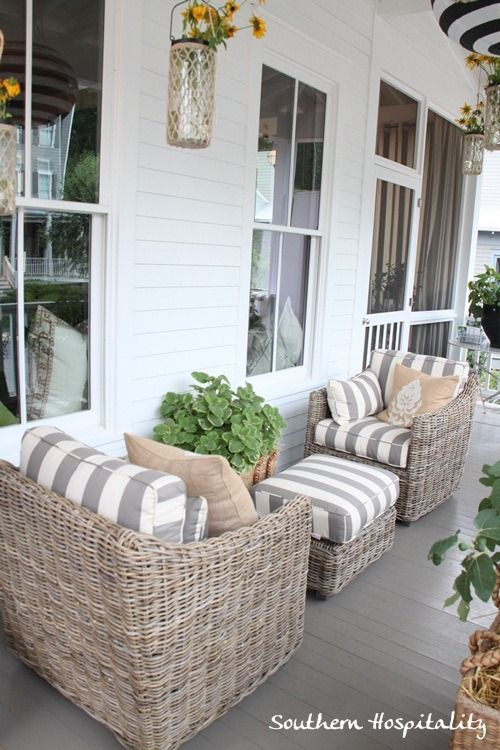 porch furniture love this combo of weathered wicker and grey/white stripes. ballard house  front EICRESI
