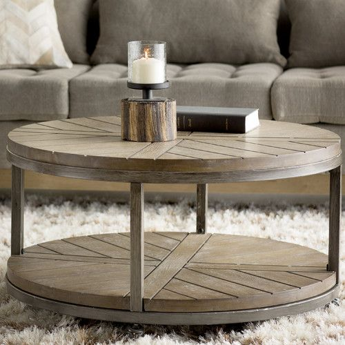 round coffee table featuring a round silhouette, caster base and contrasting wood and iron  design, JYZTLUR