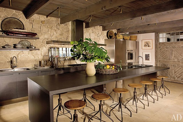 rustic kitchen a stone wall, ceiling beams, and a barnlike door add rustic touches to EHRXVZM
