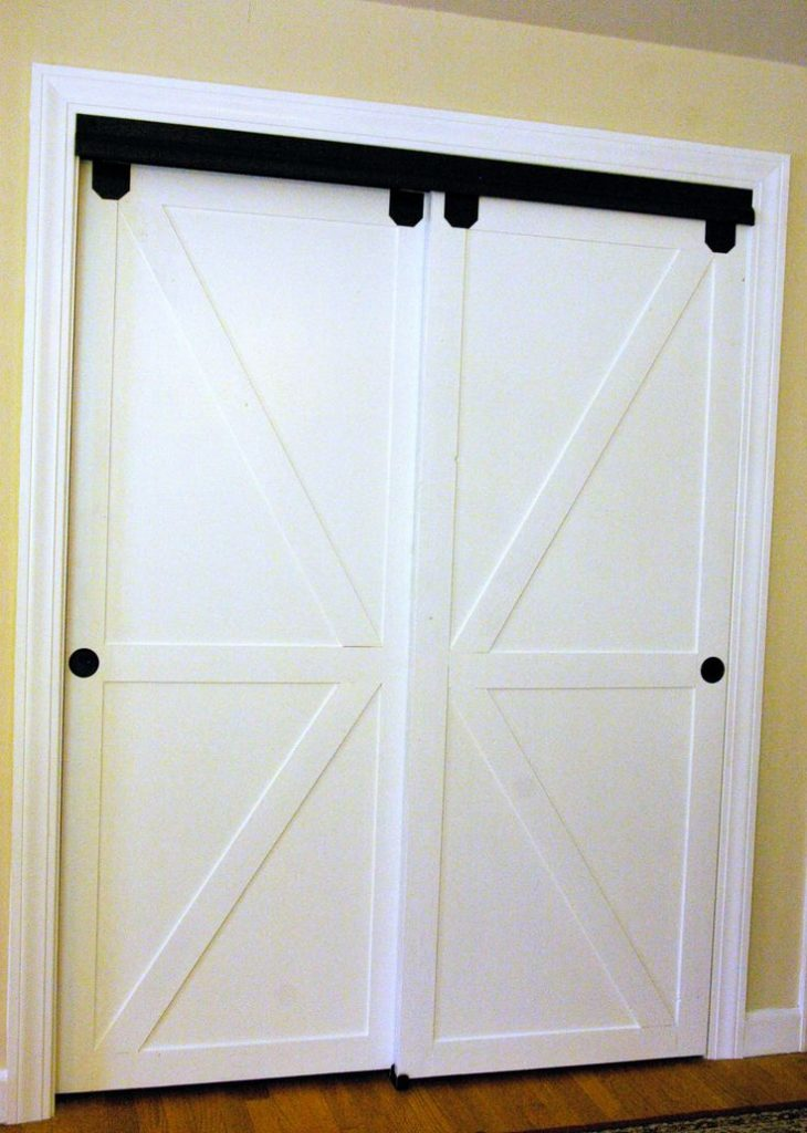 sliding closet doors diy faux barn doors on a sliding bypass closet door 02 featured on ALUATST