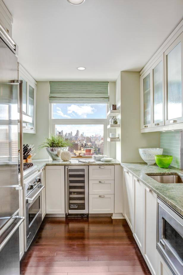 small kitchen galley kitchen exudes a cool, calm charm UICRGWH