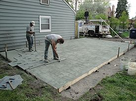 stamped concrete concrete being stamped with an ashlar slate pattern CZLYMRM