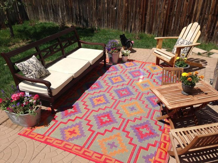 the presence of outdoor patio rugs on the terrace will designate an area YSKDJJC
