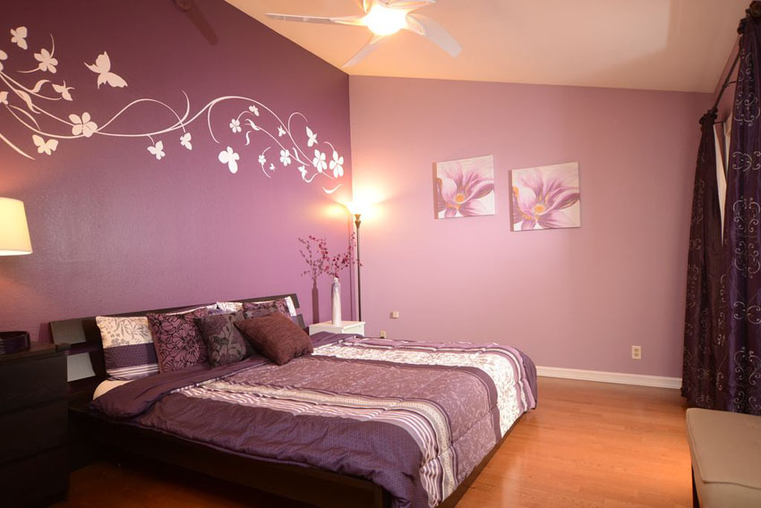 two tone purple bedroom with wall decals and curtains and bed comforter AWGTQXA
