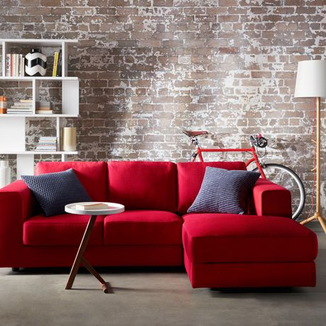 Red Sofa love the brick walls with the comfy red sectional. RGOQQDU