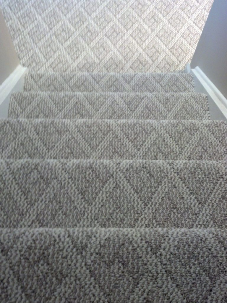berber carpet cincinnati, ohio installed on steps and basement family room.  note…..notice MGAVTQF