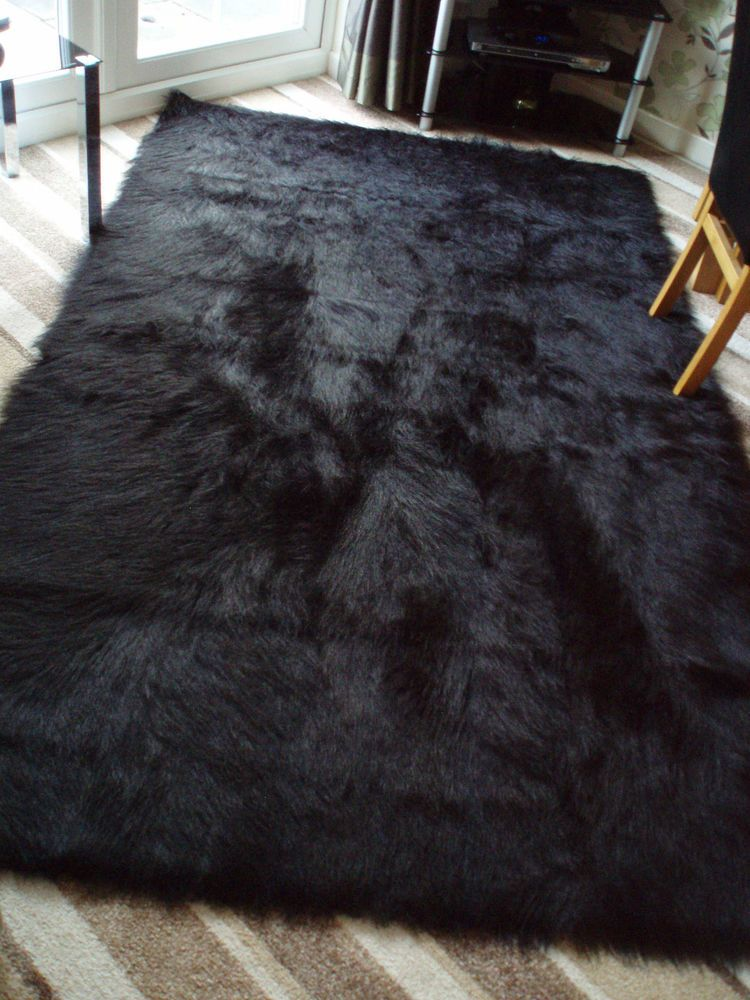 Black rugs u0027special offeru0027 large black faux sheepskin shaggy fluffy rug 150 x 240cms KGBFQMK