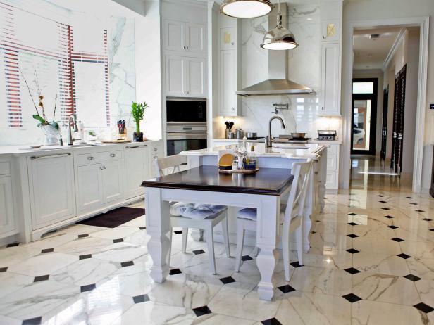 elegant transitional kitchen with black and white marble flooring TGJCSTH