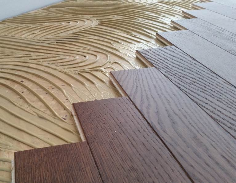 Engineered wood flooring image grid image 2. woman doing yoga on an engineered wood flooring. HCEYISB