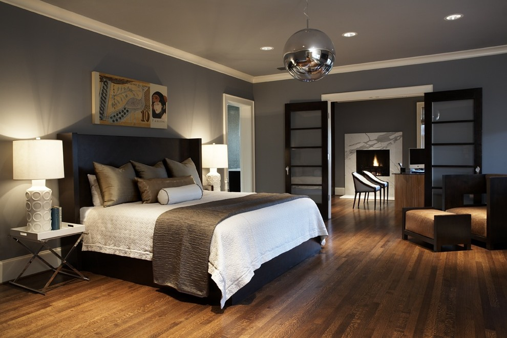 hardwood floors in bedroom home decorating example of a trendy master bedroom design in seattle with gray walls dark FGWXHBW