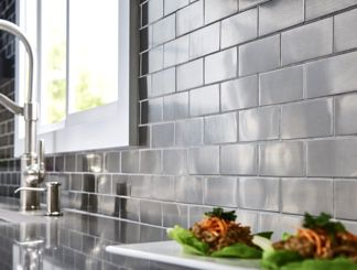 Kitchen Tile Ideas close-up of concrete and metallic industrial tile backsplash. XJRQALP