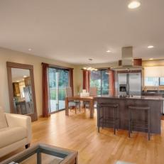 light hardwood floors modern open plan kitchen with light hardwood flooring RSJKQIC