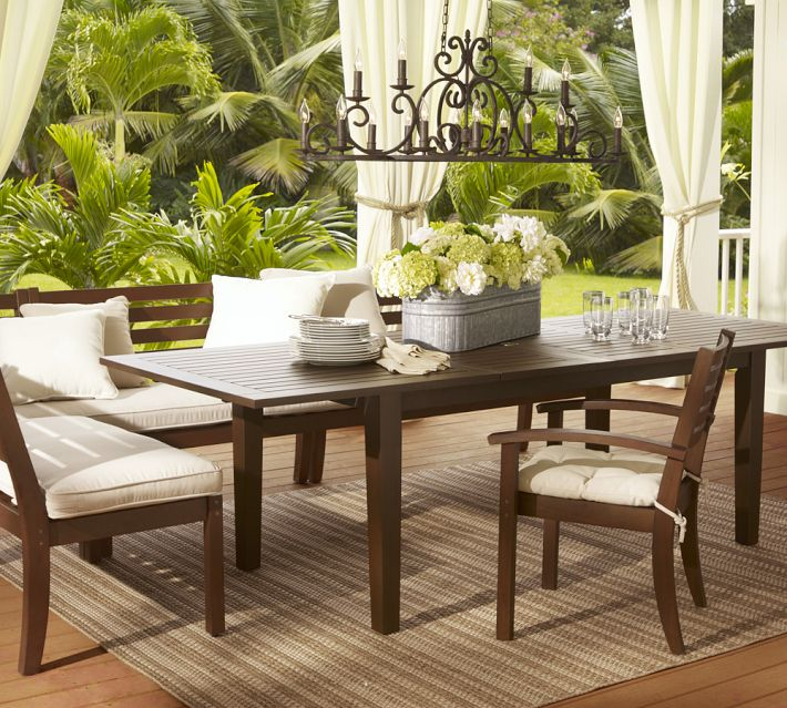 outdoor rug under patio table at $700 for the table alone, without the rug, chairs, cushions, chandelier KOYUTTS