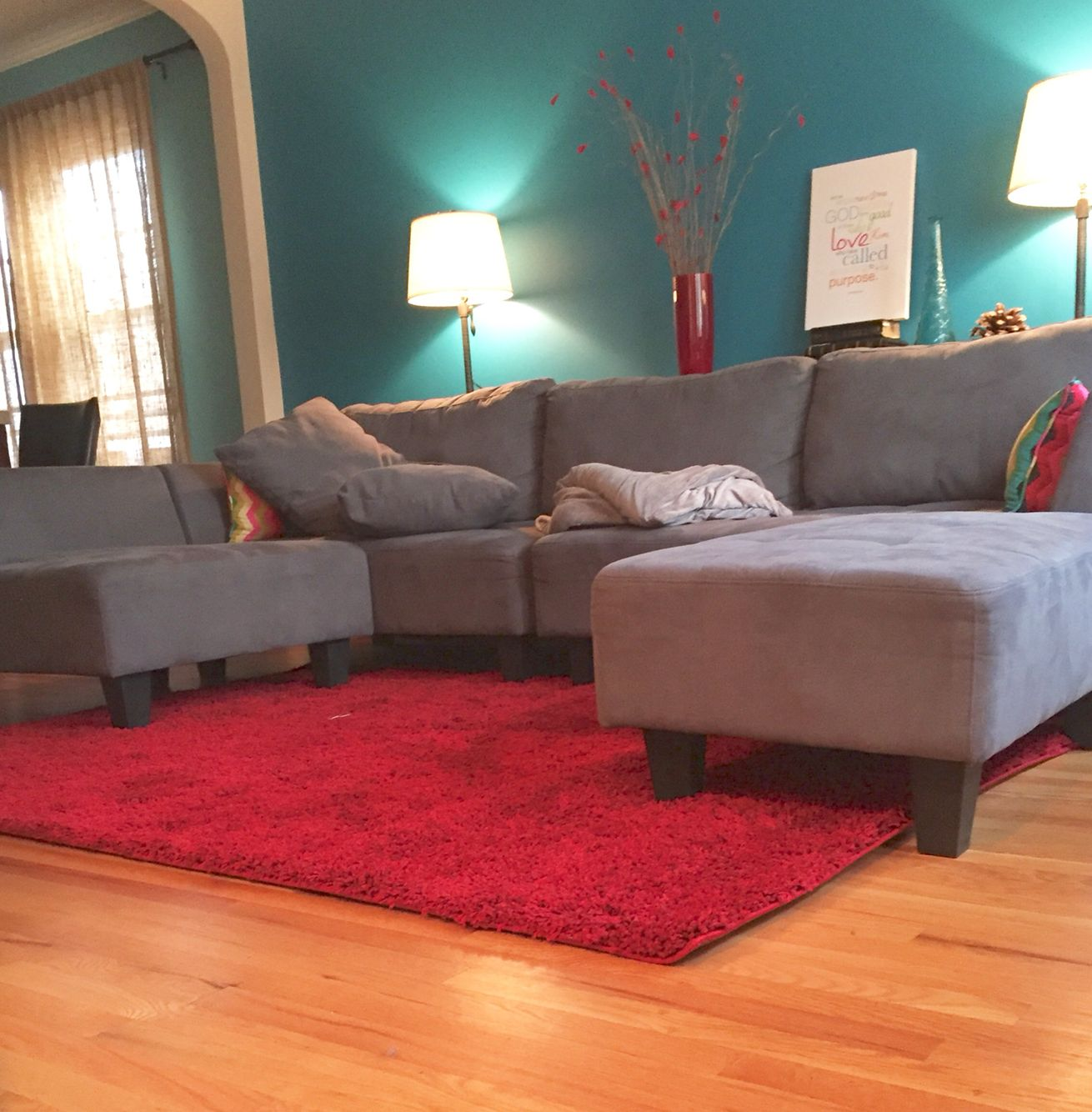 red rugs for living room living room idea: teal blue wall, grey couch, ruby red rug JYNJNBW