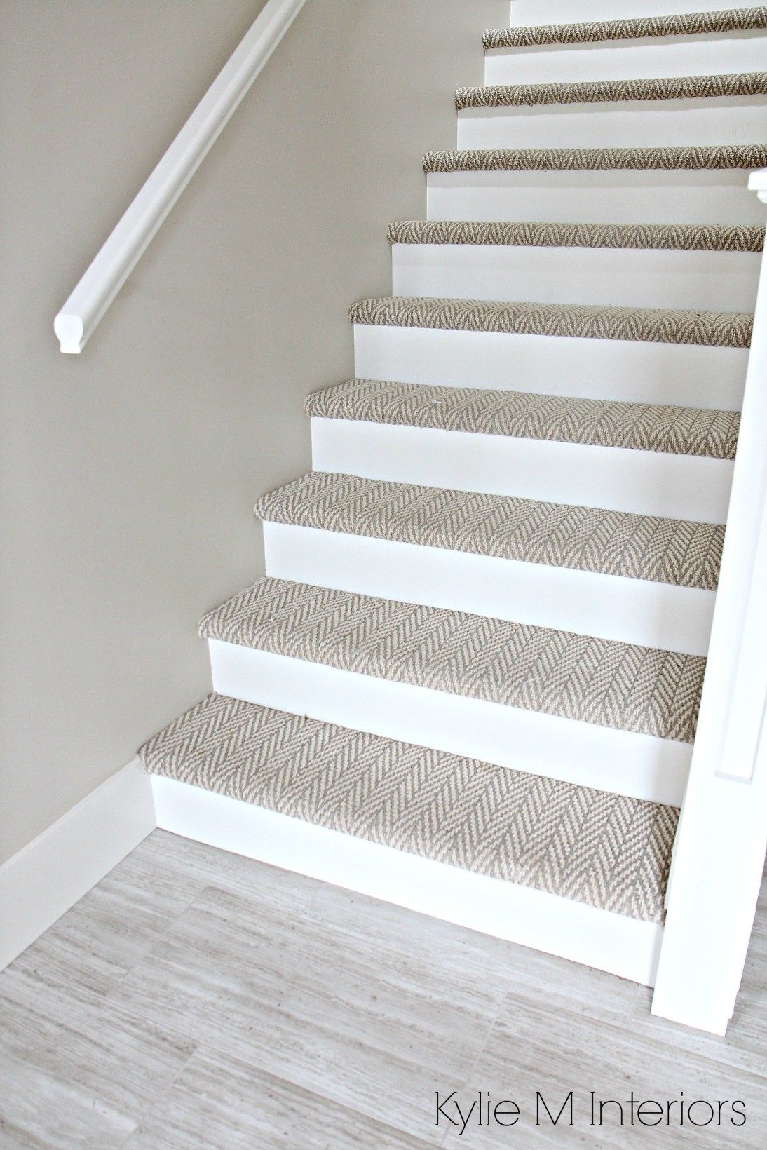 stair carpet stairs with carpet herringbone treads and painted white risers, looks like  a XCLZWKV