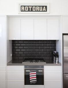 black and white kitchens with a splash of colour #kitchengoals black and white. black subway tile backsplash with black JHBKXRV