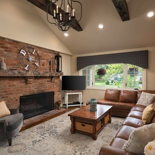 family room design ideas with fireplace inspiration for a mid-sized timeless enclosed medium tone wood floor YNXFLGE