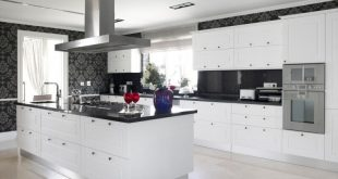 kitchen with white cabinets and black countertops this striking, contemporary kitchen utilizes black counters and bold accent XLLCOBC