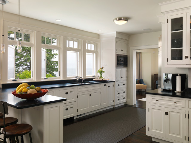 kitchen with white cabinets and black countertops york harbor maine traditional-kitchen ELFZJBF