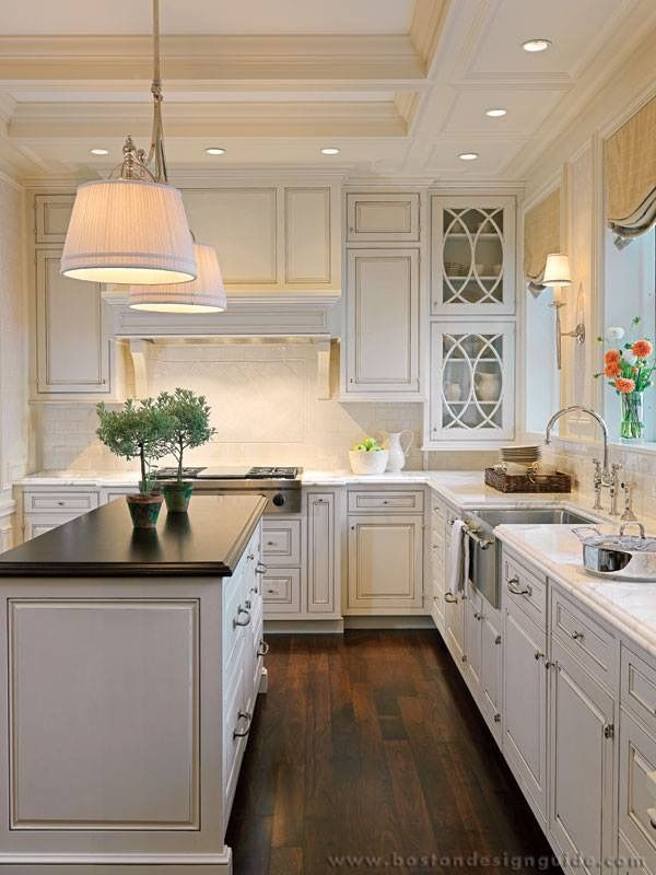 kitchens with white cabinets and dark floors light sconces by sink...white cabinets dark floors FWUGJXZ