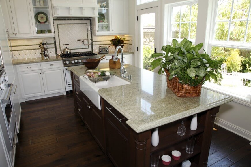 kitchens with white cabinets and dark floors this kitchen has plenty of windows for the natural light LKUBCSF