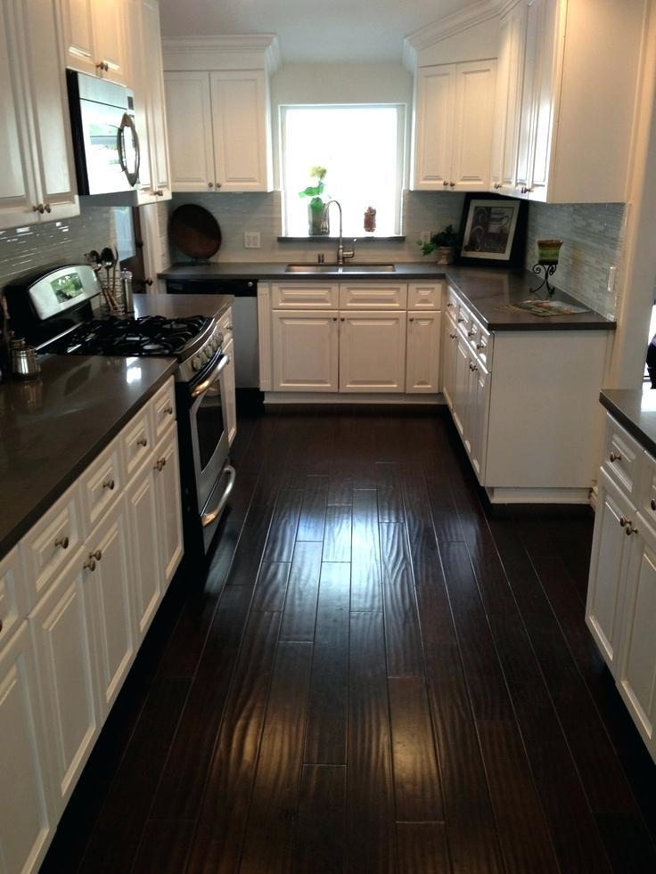 kitchens with white cabinets and dark floors white kitchen cabinets with dark floors kitchen dark counters dark UHFOZMA