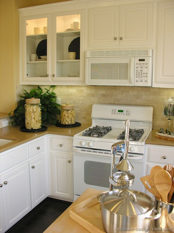 traditional white kitchen cabinets with white appliances XGEBMZP