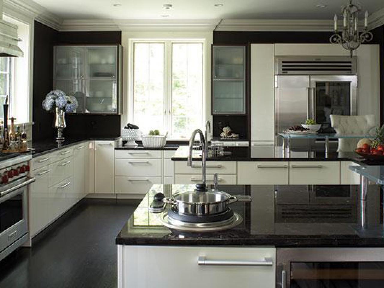 white kitchen cabinets with black countertops dark granite countertops TOUHBRI