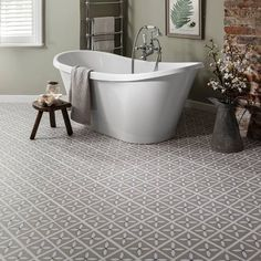 vinyl floor tiles for bathroom pebble grey floor tiles in a bathroom EKOOTIY