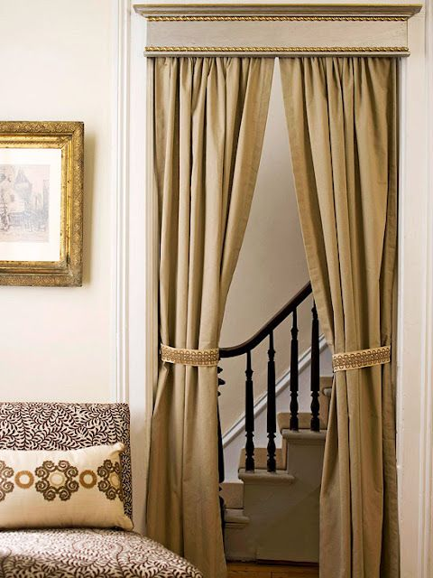 Transform a simple doorway into a pretty passage. Hang curtains in a
