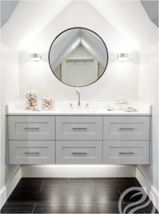 Beautiful floating vanity and love the floors. Beautiful use of