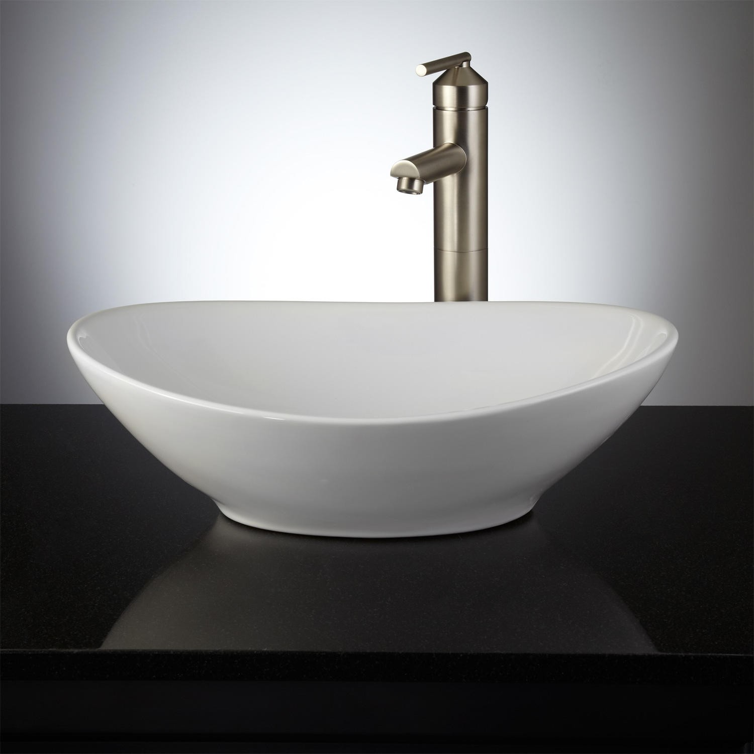bathroom sinks crafted of porcelain, this beautifully glossy sink has an oval shape and UURIVWS