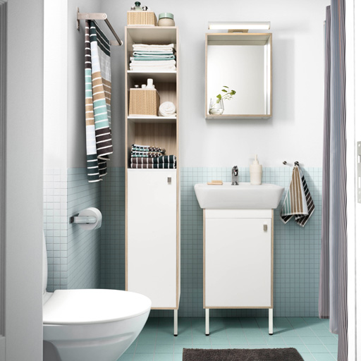 bathroom units a small bathroom with light blue floor tiles, a white high cabinet, LLTEMIU