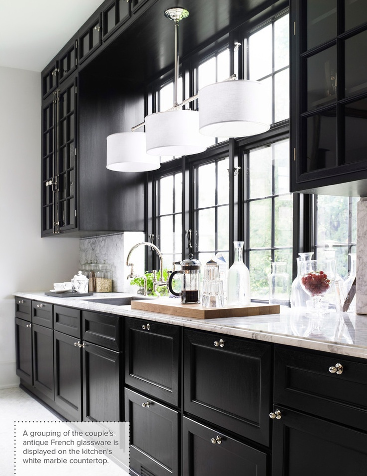 black kitchen cabinets natural light as balancing feature. GYBLWIK