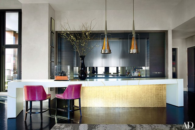 contemporary kitchens a vast white corian table with gold inlay that sits above a custom-made, VZBVGJL