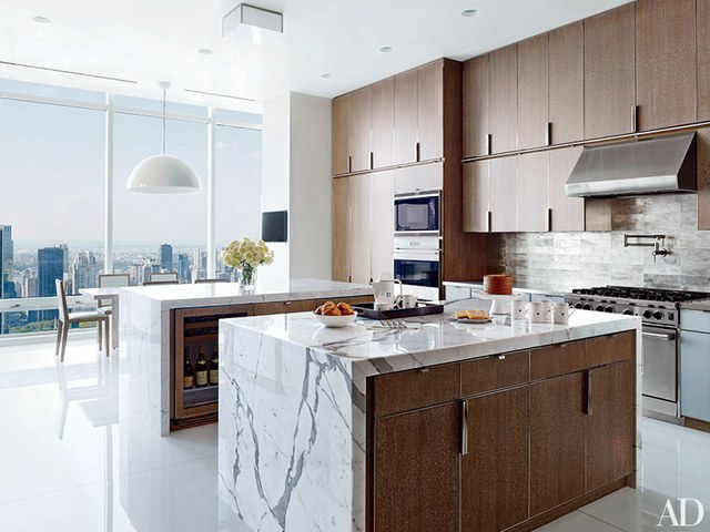 contemporary kitchens cerused-oak cabinetry lines a rockwell group-designed manhattan penthouseu0027s  kitchen. the wall PXLLNHT