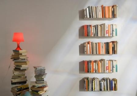 floating bookshelves the bed side even on the kitchen wall! because of the minimal . PGIUYPX