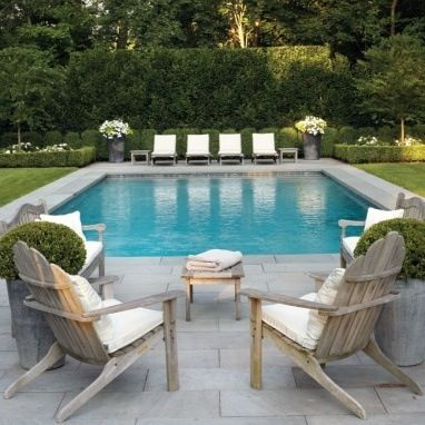 grass, grey stone paving, gorgeous pool furniture and i love the potted TGXUJUL